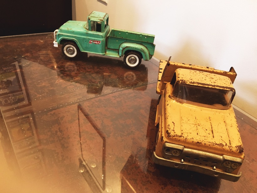 Trucks sit on a coffee table at Scenic Route Bakery in Des Moines, Iowa's East Village neighborhood.